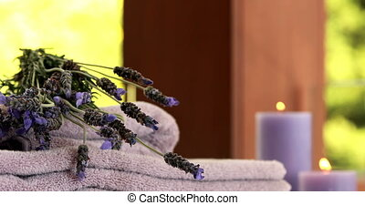 Dried lavender on purple towels at luxury spa