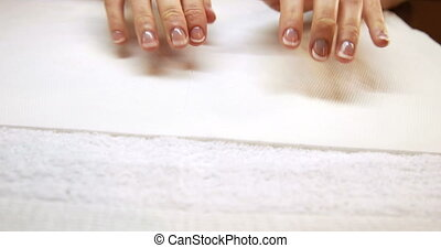 Hands showing fresh french manicure at the nail salon