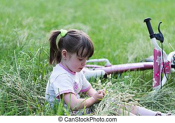 child in grass