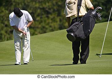 Golf - Player hitting a golf ball