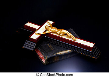 holy bible and cross - An old wooden cross with golden...