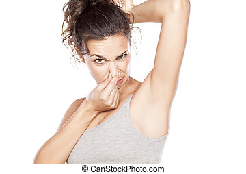 sweaty armpits - attractive girl is disgusted by her sweaty...