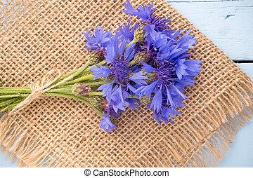 Cornflower. - Cornflower on wooden background. Studio...