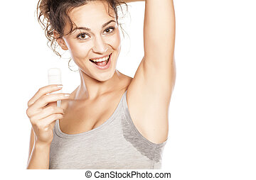 deo stick - happy girl holding a deodorant stick in hand