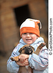 little boy with puppies - little boy playing with puppies...