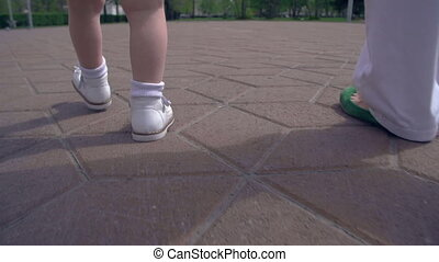Toward Future - Slow motion of unrecognizable child walking...