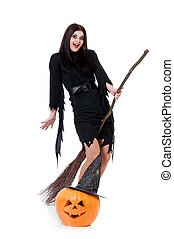 Flying witch - Young witch with broom and halloween gourd...