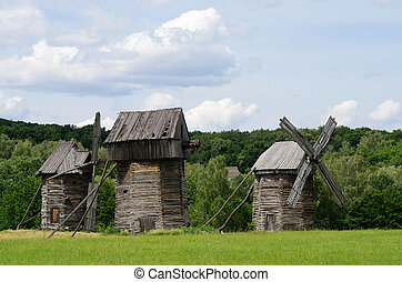 Three traditional old Ukrainian rural wind turbines...