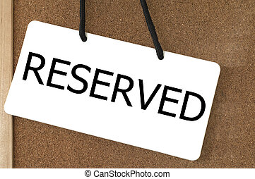 Reserved sign label on wooden board