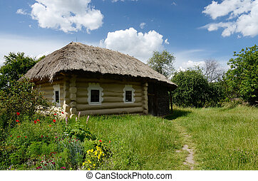 Traditional Ukrainian rural house with hay roof...