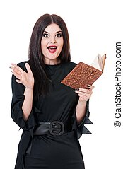 Shocked witch with book for spells isolated on a white...