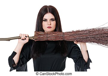 Upset witch with broom over white background close-up