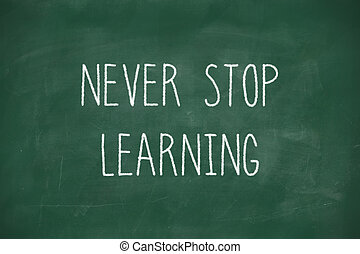 Never stop learning handwritten on blackboard - Never stop...