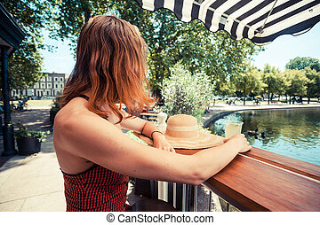 Young woman drinking lemonade in the park