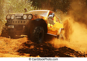 Racer at terrain racing car competition, the car try to...