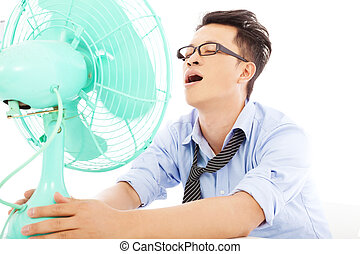 business man  suffering a hot  summer heat with fans