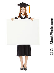 happy young female graduation students with blank board