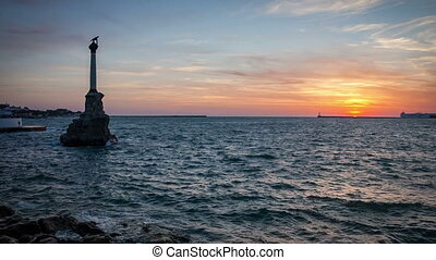 Sunset and a monument in the sea