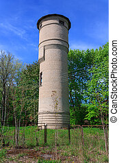 Brick water tower in the forest
