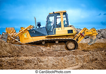 bulldozer or excavator working with soil on construction...