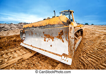 close-up of bulldozer blade, industrial machines working in...