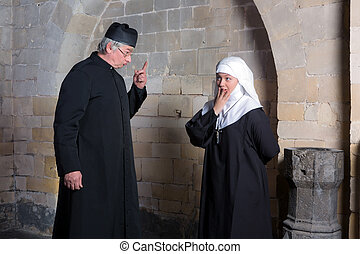Vicar reprimand - Priest giving a young novice a reprimand
