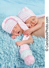 newborn babies with pink hats - Two adorable newborn twin...