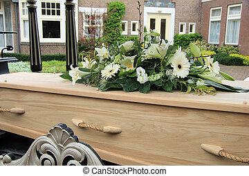 Funeral flowers on a casket, funeral service