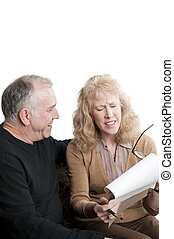 Older couple going over accounts for retirement, isolated on...