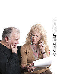 Older couple going over accounts