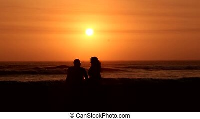 couple in the sunset at beach
