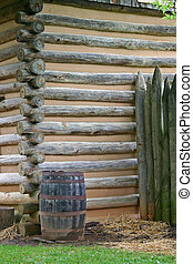 Cabin Corner & Barrel - a barrel near the corner of a log...