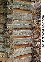 Cabin Corner - the corner of a log cabin near a stone...