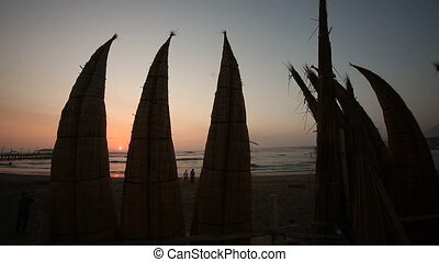 Typical boats in Trujillo, Peru - Caballito de totora -...