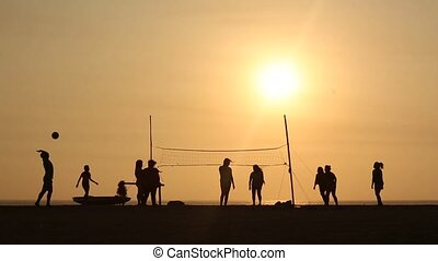 Beach Volleyball in sunset - video footage people playing...
