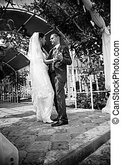 Photo of bride and groom dancing in alcove - Monochrome...