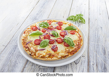 Homemade pizza - Homemade Pizza with tomatoes red onions and...