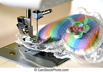Sewing machine. - Sewing machine with a needle and thread...