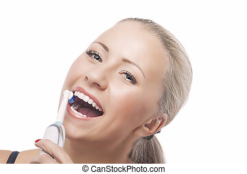 Dental Health: Blond Caucasian Woman Brushing Her Teeth with...
