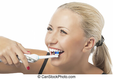 Dental Health: Caucasian Blond Woman Brushing Her Teeth by...