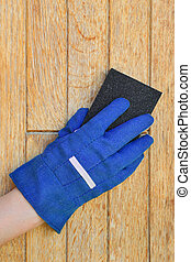 Plank preparation with sanding sponge - Worker hand in glove...