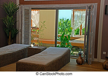 Wicker furniture in spa relax room. - Wicker furniture and...
