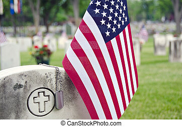 dog tags on veteran'r tombstone - Military dog tags on a...