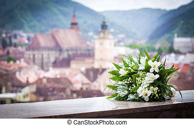Wedding bouquet spring flowers with Brasov city view...