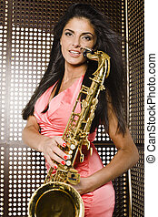 beauty young woman playing on saxophone