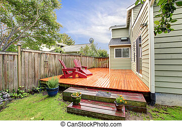 Wooden deck with red chairs