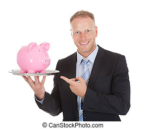 Businessman Showing Piggybank On Tray - Midsection of mid...