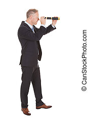 Businessman Looking Through Handheld Telescope - Side view...