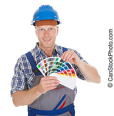 Handyman Showing Color Swatches - Portrait of confident mid...