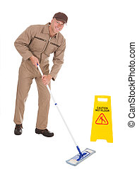 Male Servant Mopping Floor By Wet Floor Sign - Full length...
